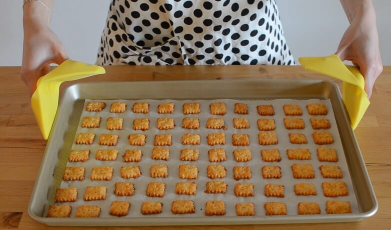 Cooked Cheez-Its squares in oven tray