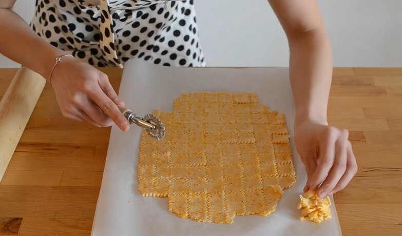 cutting Cheez-Its dough with roller