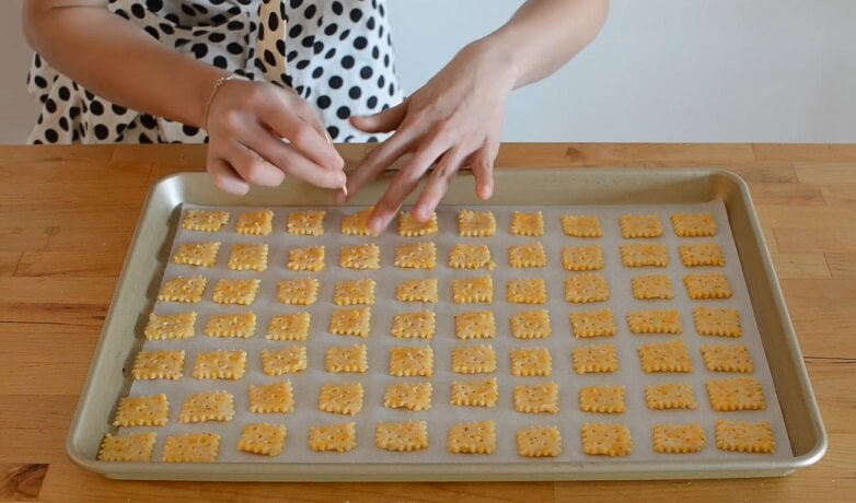 poking Cheez-Its squares with straw